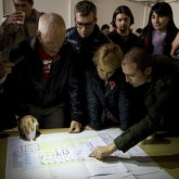 Lama Ole, Caty and friends are shown the plans to transform the Beaufoy