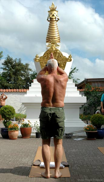 Lama Ole Nydahl doing prostrations by the stupa in Rdby, Denmark