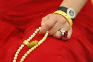 a mala being used in meditation